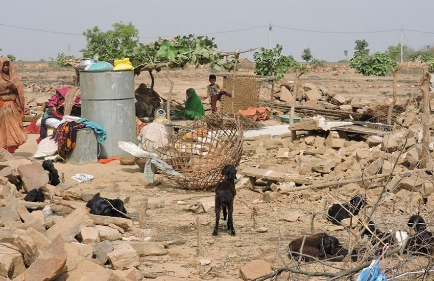 In The Rainy Season, The Tribals' Houses Were Demolished Under Open Air