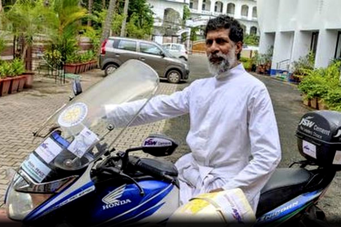 Catholic priest in India rides bike to call attention to environment